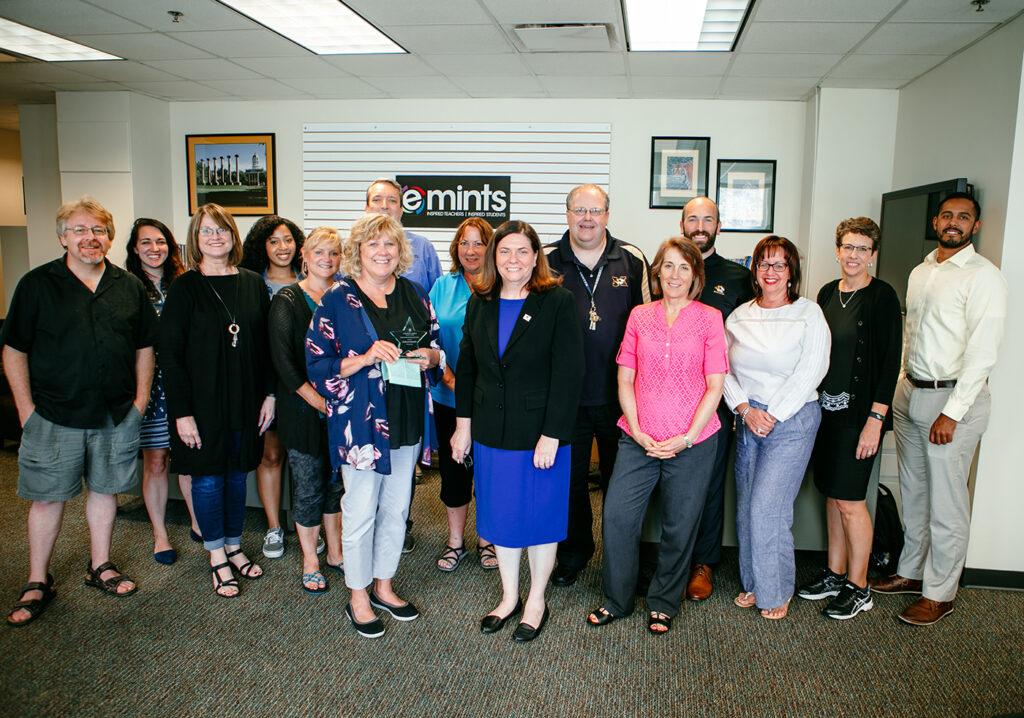 A large group photo celebrating Michelle Kendrick's Porter Graham Award.