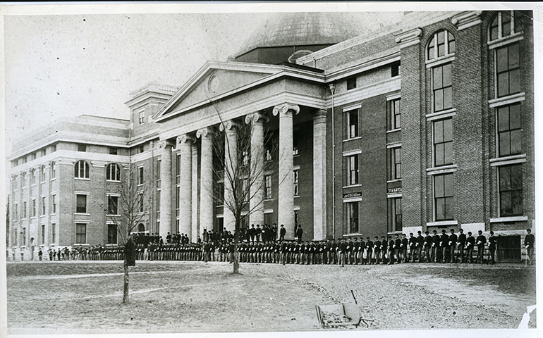 Cadets parade in front of Academic Hall in 1885.