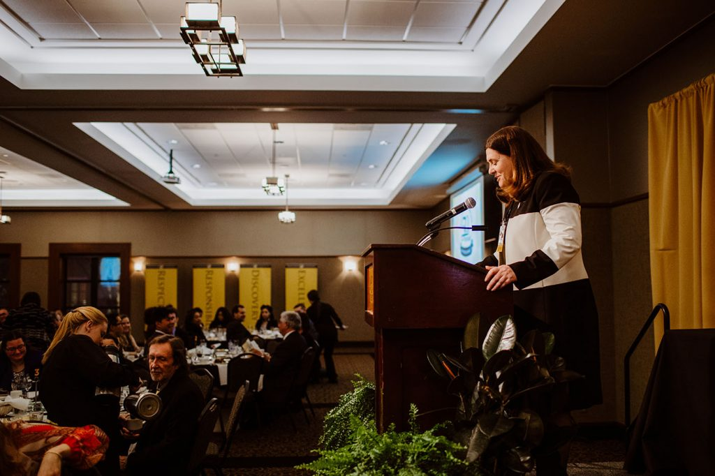 Dean Kathryn Chval presents an award at the 50th Annual Awards Banquet, University of Missouri College of Education
