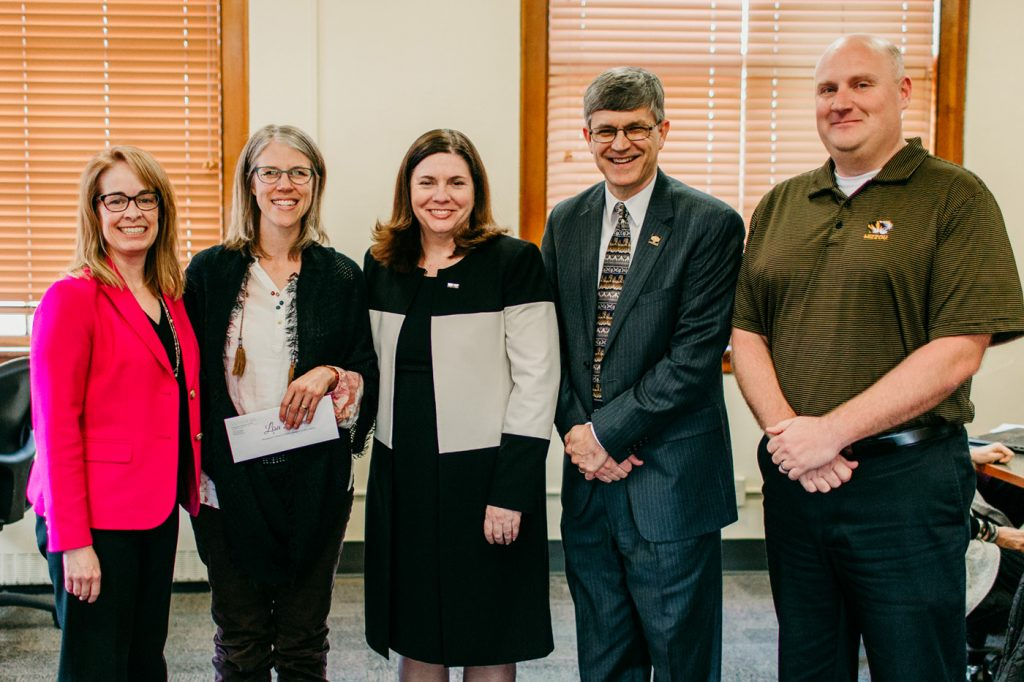UM System Chief Human Resources Officer Marsha Fischer, Lisa Dorner, Dean Kathryn Chval, Provost Jim Spain, and Brad Curs, ELPA Department Chair, were on hand to present the award.