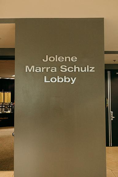 A photo of the wall stating Jolene Marra Schulz Lobby.