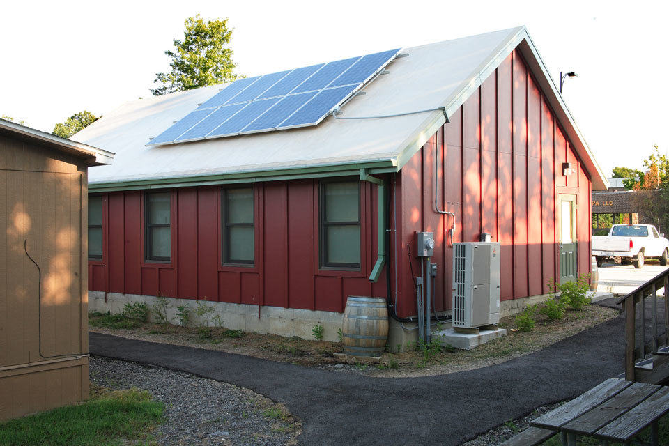 A green school building with solar panels.