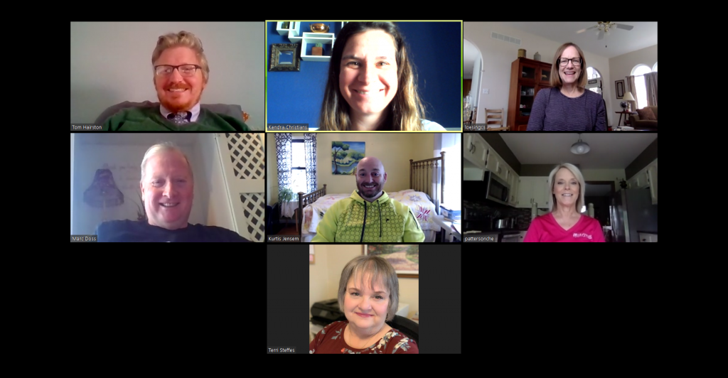 A photo of seven people on a zoom call.