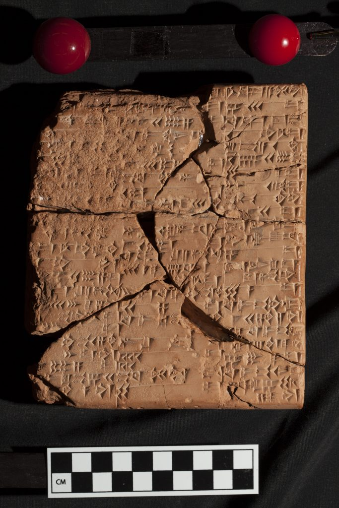 A close up photo of a broken clay tablet