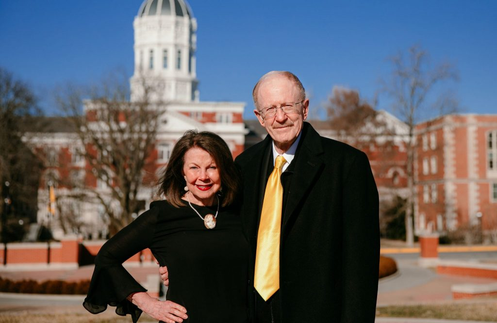 Photo of Gary Coles and Patrica Coles with Jesse Hall in the background.