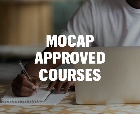 Mizzou Academy MOCAP Approved Courses, photo of African American man holding pen and writing in notebook with laptop open
